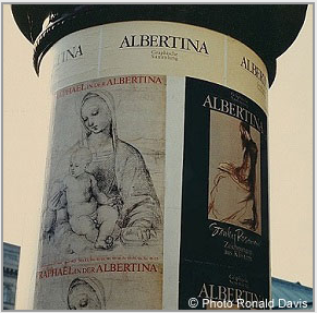 "At the entrance to the Albertina, Vienna, the column displaying the posters announcing the museum's exhibitions ""Raphael in der Albertina"" and ""Stanley Roseman - Zeichnungen aus Klöstern,"" 1983. © Photo by Ronald Davis"
