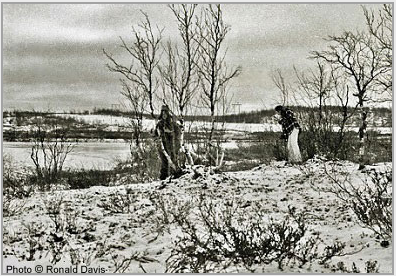 Myrdene Anderson (left) and Stanley Roseman (right) collecting brushwood and twigs with which to build a smokey fire at the river's edge to signal Ris'ten's brother to come to get them in his rowboat. Kautokeino, 1976. Photo © Ronald Davis