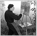 Stanley Roseman painting at his easel in the open air, France, 2014.
